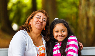 hispanic grandma and granddaughter
