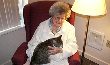 84 year old woman with a cat