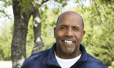 middle aged african american man smiling